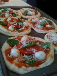 Mini Margherita pizzas. Maybe go even smaller with muffin tins