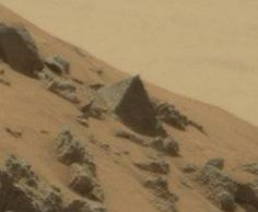 "In the latest news on space exploration, NASA's Mars rover found what looks like the image of a Great Pyramid found back on Earth. The images are part of a series of anomalies found on the Red Planet. This May 7 ""pyramid"" image has stargazers believing that intelligent life exists or once thrived on Mars. In a June 20 report, ExoPolitics said NASA's Curiosity Rover discovered a large triangle-shaped stone structure that conjures up images of pyramids."
