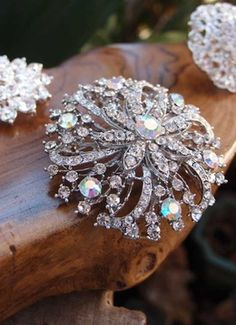Add a burst of sparkle to clothing, bouquets, corsages, and centerpieces with a crystal diamond pin or brooch.