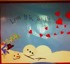 Love is in the Air: This bulletin board shows winter melting away and 'let it snow' tumbling down. Hearts for Valentines day are being 'blown in'.