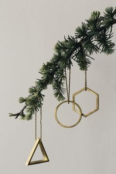 Call it the new geometree: Our favorite Christmas tree ornaments this year come in angular shapes that look great against the lines of the branches. Here a