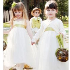 Flower girl & ring bearer adorableness with touches of your color! :) Love the vest and hat on the boy.