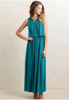Simple and elegant, this lovely chiffon maxi dress is perfected with an allover pleated design in a teal-blue hue. Finished with a tiered bodice for added movement, this maxi dress is sure to turn heads at your next cocktail party.