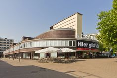 The Schaubühne am Lehniner Platz is a famous theatre in the Wilmersdorf district of Berlin, located on the Kurfürstendamm boulevard. It is a conversion of the Universum cinema, built according to plans designed by Erich Mendelsohn in 1928.
