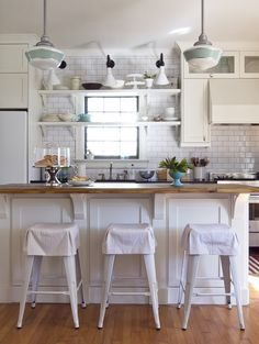 Pop of color to the kitchen. With a hint of retro style pendant lamps.