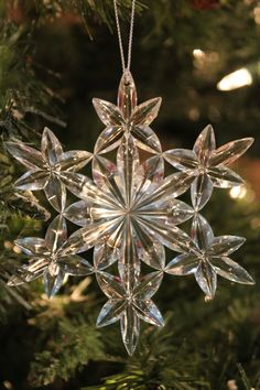 DEPARTMENT 56 ACRYLIC SNOWFLAKE ORNAMENT Delicately designed iridescent acrylic snowflakes from Department 56 add a glass like shimmer to any tree.