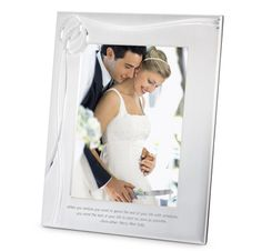 This silver-plated frame is destined to become a cherished heirloom. It's       stylishly decorated and embellished with the symbol that signifies your love, a pair of intertwined crystal wedding rings. With your names and wedding date     personalized on the front, this is a romantic gift you'll want to display.      Coordinates beautifully with the rest of our Double Ring                        Collection.<br><br>-Want your photo to be delivered inside your frame? Choos...