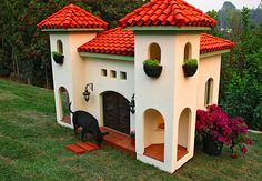 luxury dog houses - if he doesnt want the dog inside i wonder if i can get this in the back yard :)
