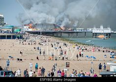 Eastbourne, East Sussex, England, UK. 30th July, 2014. #Eastbournepier catches fire and burns © Rohan Van Twest/Alamy Live News