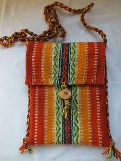 A great little cell telephone neck purse.  This would be great fun to make on a Mirrix Loom.