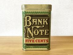 A 1930s Bank Note Five Cents humidor cigar tobacco tin that held 25 cigars. A wonderful tobacco tin, and a scarce item you dont find very