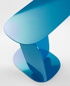 Thin sheets of metal balance on one another to form this side table by Claesson Koivisto Rune.