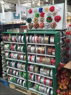 This palletized Christmas Ribbon and Bow display was seen Labor Day Weekend amongst the early Halloween and Fall merchandise. It could be an island display with corrugated cartons facing every dire...