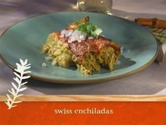 Sara Moulton's Swiss Enchiladas.  -  Love these. skip most of the cream.. and no need to soften the tortillas in oil.. just pop in the microwave for a few seconds in a damp cloth.