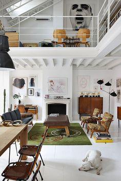 white floors + vintage furniture + art on the walls + mezzanine + industrial lighting...