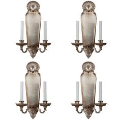 A set of four silver over bronze wall sconces by E.F Caldwell. Signed.  Circa 1900-1915.  5.5 D x 11 W x 18 H