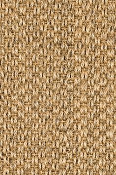 Tiger Eyes sisal rug in Natural colorway, by Merida.