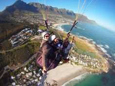 Take the plunge: Choose an alternative route down Cape Town's iconic Lion's Head. The hike up the hi Cape Town South Africa, Table Mountain, Paradise On Earth, Local Attractions, Adventure Activities, Paragliding, Most Beautiful Cities, Africa Travel, Places To See