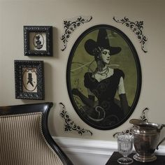 I really like the framed silhouettes in this photo (the decals and witch are cool too) the frames almost look glittered