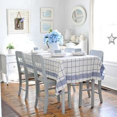 A vintage blue and white tablecloth becomes the inspiration for this dining room's decor.