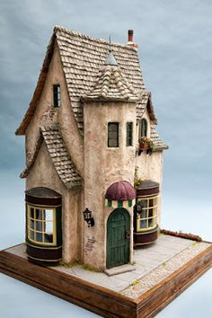 """""""The Smuggler's Cottage"""" built on a rock in a lake. The lower room is carved from the rock. The upper room and loft are built atop the rock.-----Good Sam Showcase of Miniatures: Fantasy Structures by Rik Pierce, Frogmorton Studios"""