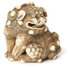A large ivory netsuke of a shishi School of Tomotada, Kyoto, late 18th century; sold 23,495 USD; 10/05/17.