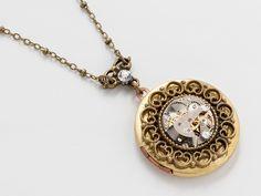 Steampunk Locket Necklace silver watch movement gears Swarovski crystal gold brass filigree round  #SteampunkNecklace #SteampunkJewelry #SteampunkJewelrybyMariaSparks
