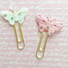 A personal favorite from my Etsy shop https://www.etsy.com/listing/277884362/white-and-pink-butterfly-paperclips-set