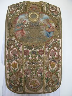 Stonyhurst College - Wintour chasuble. Helena Wintour spent a closeted life making vestments after the execution of her father along with other members of her family for their role in the Gunpowder Plot. The panel depicts the vision of the lamb from the book of Revelation.