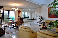 Interior Design Philippines, Subic, Real Estate Houses, Living Area, Oversized Mirror, Homes, Lighting, Table, Furniture