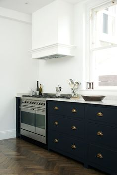 Kitchen with a range cooker, white walls, black counters