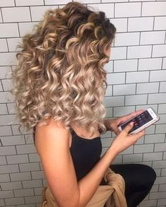 curly blonde hair.