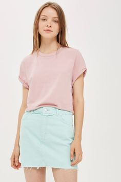 A MOTO denim mini skirt in mint with a raw edge waistband. Team with your favourite tees for summer time styling.
