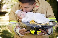 newborn pose with firefighter daddy. LOVE IT!!