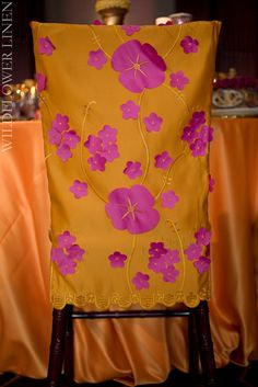 #floral appliques in this color combo help create a whimsical garden theme at any event