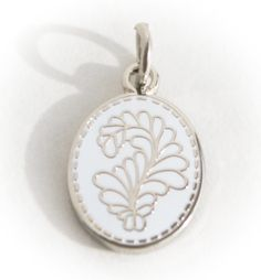 One of our favorite charms! A beautiful stitched feather. Perfect for anyone!