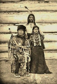 RUSHING BEAR with one of his son and his daughter , circa 1880