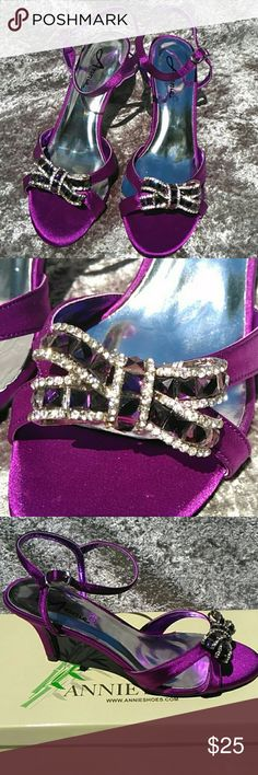 NWT 7W Crystal & Satin Heeled Dress Shoes NWT. Never worn, only tried on. Stunning amyethest satin heeled dress sandals. They have a purple crystal encrusted bow across the vamp & what I think of as a kitten heel. Approximately 1 & 3/4 in. Adjustable buckle strap on the ankle. It says 7WW but I personally think it runs a little smaller on the width. More like a 7W.  Thanks for visiting my closet. I always entertain offers and I love to bundle and give you even deeper discounts. Thanks again…