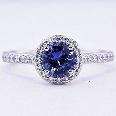 Platinum Sapphire Halo Diamond Ring with Side Stones. Set with a 6.5mm Round Blue Sri Lanka Sapphire.