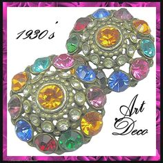 Large flashy Art Deco jewel-tone rhinestone pierced metal earrings are gorgeous from the 1930's and in very good vintage condition. Certainly they must have been inspired by the popular Thief of Baghdad genera of jewelry of 1930's and early 1940's. These beauties bear the patent number 1967965 (July 24, 1934) and in our option are quite comfortable to wear check them out with the scan able photos from brendastreasures on rubylane.com!