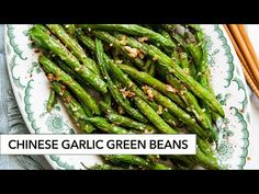 These Chinese-style garlic green beans are simple and delicious. The green beans are flash fried, gently blistering the skin and then sautéed with garlic. Chinese Garlic Green Beans, Chinese Long Beans, Sauteed Green Beans, Fried Green Beans, Pork And Cabbage, Asian Recipes, Chinese Recipes, Chinese Food, Green Bean Recipes