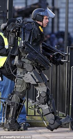 Warriors: Tom was joined on set by an actor dressed in what looked like robot inspired military armour