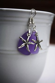 Inspired by the ocean, I created these gorgeous earrings using lavender cultured sea glass and a pewter starfish. Perfect for your next party or
