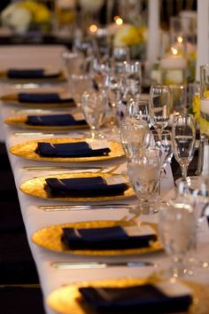 Gold chargers, blue napkins, white tablecloths