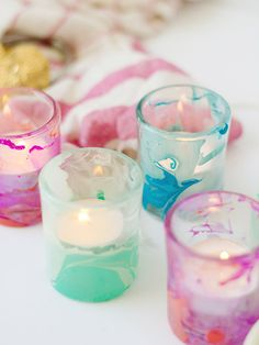 DIY : nail polish marble candles holder ( http://www.hgtv.com/handmade/use-nail-polish-to-create-marbled-votives/index.html )