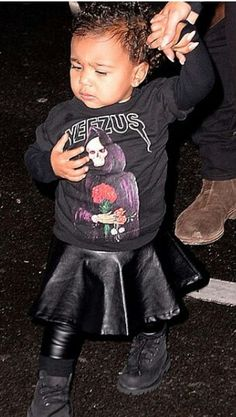 North west wearing kardashian kids leather skirt and leggins and yezzus shirt