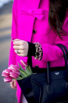 Pink J.Crew coat and pink chain bracelet.