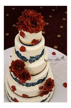 6 Tier Wedding Cake in Navy Blue, Maroon and a touch of Gold... All sugar roses and edible lace...