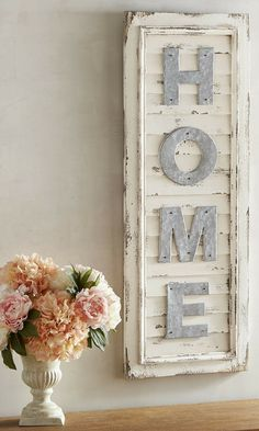 There's no place like it. This piece is crafted to resemble antiqued wooden shutters with galvanized iron letters that spell out your favorite place to be. | farmhouse decor | wall art | wall decor | home sign | antique shutters | afflink #WallSconces