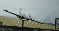 ex RNZAF Aermacchi MB339 @ Wanaka. RAAF T2 Hawks fly in the background.